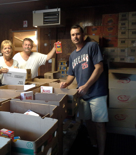 Bridgett, Barney, and Mark packing dry goods into  boxes