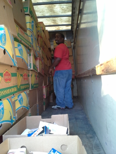 Janon stacking boxes of dry goods into truck